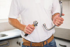 Plumber fixing pipe with wrench Royalty Free Stock Photos