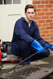 Plumber Fixing Problem With Drains. Plumber Fixes Problem With Drains Stock Images