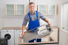 Plumber Fixing Sink Stock Images