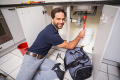 Plumber fixing under the sink Stock Photo