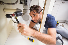 Plumber fixing under the sink Stock Photography