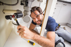 Plumber fixing under the sink Royalty Free Stock Photos