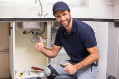 Plumber fixing under the sink Stock Images