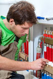 Plumber fixing the valves Royalty Free Stock Image
