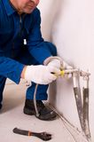 Plumber fixing water pipe Royalty Free Stock Photography
