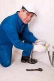 Plumber fixing water pipe Royalty Free Stock Image