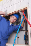 Plumber fixing water supply Stock Photography