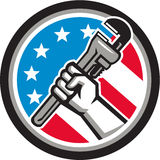 Plumber Hand Pipe Wrench USA Flag Side Angled Circle. Illustration of a plumber hand holding adjustable pipe wrench in an angled position viewed from the side Stock Images