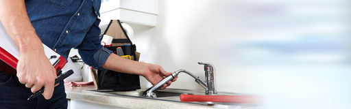 Plumber hands and water tap Stock Images
