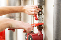 Plumber hands working with pipeline connections Stock Photo