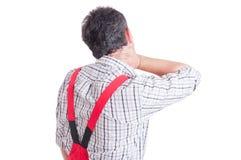 Plumber having back neck pain concept Stock Photos