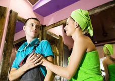 Plumber having flirt with young girl at home. men with young female customer before flirt Stock Image