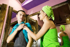 Plumber having flirt with young girl at home. men with young female customer before flirt.  Stock Photo