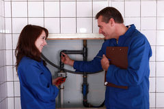 Plumber and his apprentice Royalty Free Stock Photo