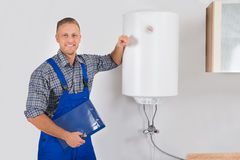 Plumber Holding Clipboard And Pen Stock Photography