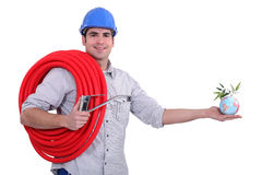 Plumber holding coil and globe Stock Photo