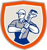 Plumber Holding Giant Monkey Wrench Shield Stock Photo
