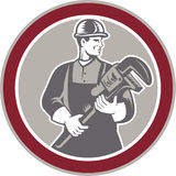 Plumber Holding Giant Wrench Woodcut Circle Stock Image