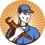 Plumber holding monkey wrench Stock Image