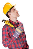Plumber holding pipe wrench. Over white background Stock Photography