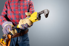 Plumber holding pipe wrench Royalty Free Stock Photography
