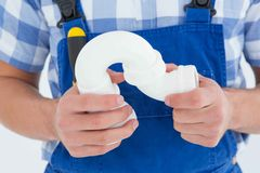 Plumber holding sink pipe on white background Stock Photos