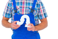 Plumber holding sink pipe on white background Stock Image