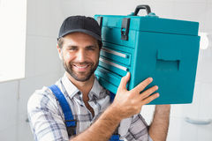 Plumber holding toolbox on shoulder Royalty Free Stock Photos