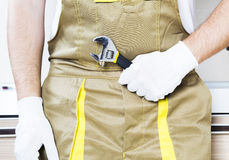 Plumber holding wrench stock photography