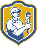 Plumber Holding Wrench Side Shield Retro Royalty Free Stock Image