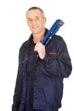 Plumber holding a wrench Royalty Free Stock Photo