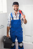Plumber holding wrench and toolbox Royalty Free Stock Images