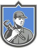 Plumber Holding Wrench Woodcut Shield Stock Images