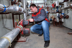 Plumber Installing Heating System Boiler Room Royalty Free Stock Photo