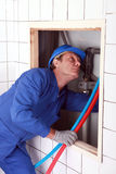 Plumber installing pipes Royalty Free Stock Photos