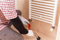 Plumber installing a thermostatic valve Royalty Free Stock Photo