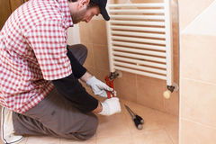 Plumber installing a thermostatic valve Stock Images