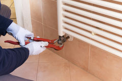 Plumber installing a thermostatic valve Stock Image