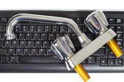 Plumber and keyboard Stock Images