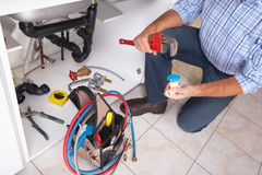 Plumber on the kitchen. royalty free stock photo