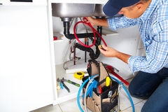 Plumber on the kitchen. Plumber with Plumbing tools on the kitchen. Renovation royalty free stock photo
