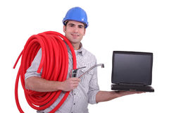 Plumber with a laptop Stock Photo