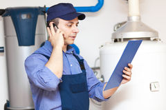 Plumber making a phone call Royalty Free Stock Photography