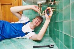 Plumber man repair leaky faucet tap stock image