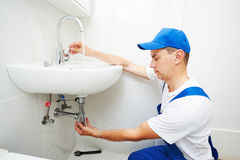 Plumber man repair leaky faucet tap. Plumber worker working with spanner during leaky faucet tap repair stock photos
