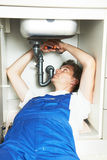 Plumber man worker with kitchen sink Royalty Free Stock Images