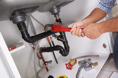 Free Plumber On The Kitchen. Royalty Free Stock Photography - 59609307