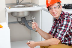 Plumber with pipe wrench stock image