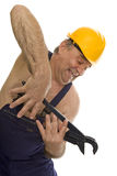 Plumber with pipe wrench and safety helmet Stock Photography