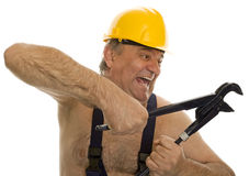 Plumber with pipe wrench and safety helmet Royalty Free Stock Image